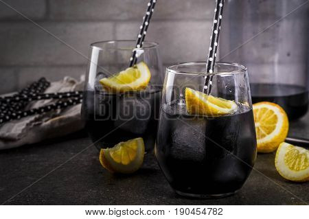 Black Lemonade With Ice And Lemon