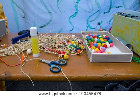 wooden table decoration itself to tinker around with scissors pencils and balls.