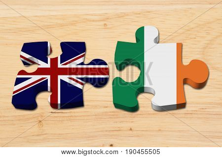 Relationship between the Britain and Ireland Two puzzle pieces with the flags of Britain and Ireland on wood 3D Illustration