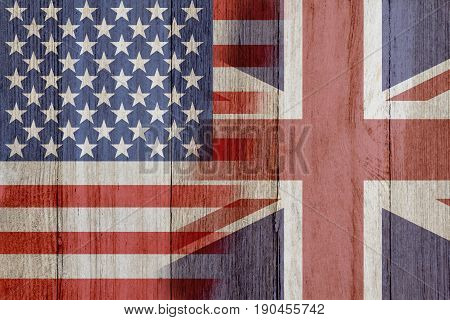 Relationship between the USA and Britain The flags of USA and Britain merged on weathered wood