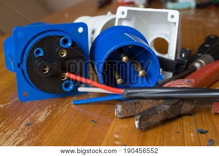 Different electrical tools on wooden table Power outlet stationary