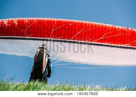 Paraglider catch a wind with his paraplane.jpg