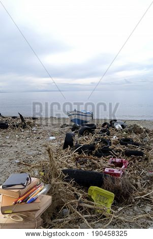 environmental pollution. A beach of the Calabria with great piles of trashtires waste and polluting material