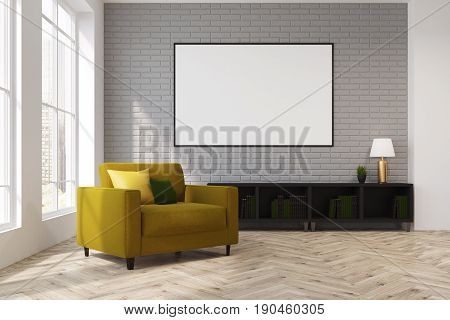 Gray living room interior with a yellow armchair with cushions on it. There is a framed horizontal poster above a dresser. Lamp. 3d rendering mock up
