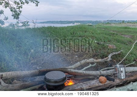 Cooking Food At The Stake. Picnic On The River Bank.