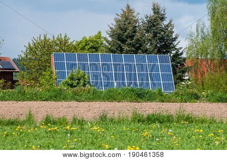 House With Solar Panels On Roof - Regenerative Energy System Electricity Generation