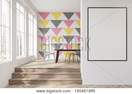 Dining room interior with a colorful triangular pattern on a wall tall windows and a round table with yellow gray and white wooden chairs near it. Vertical poster. 3d rendering mock up