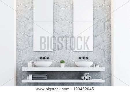 Gray bathroom with a gray wall two white sinks and two tall rectangular mirrors hanging above them. 3d rendering
