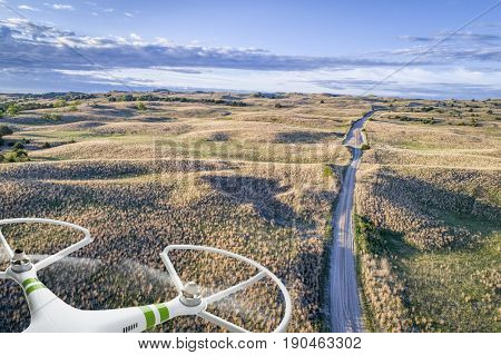 aerial view of a farm road in Nebraska Sand Hills with a flying drone
