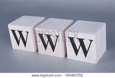 www letters cubes photo on grey background