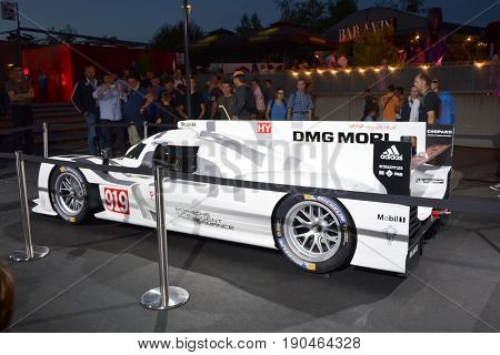 LE MANS, FRANCE - JUNE 12, 2014 : The racing car Porsche 919 hybrid at a racing circuit 24 hours at Le mans, France