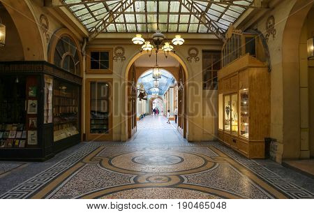 PARIS, FRANCE - June 08, 2017: Galerie Vivienne is an ancient historical passage with shops and restaurants and a tourist attraction in Paris in France