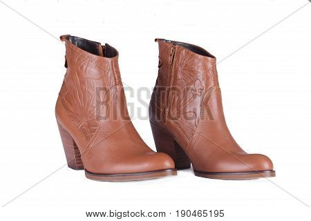Pair of Woman Brown boots isolated on white