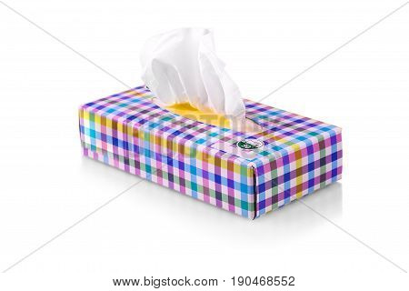 colored box with paper napkins on white background