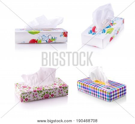 Set of colored boxes with paper napkins on white background