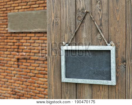 Blackboard On Wooden Door At Entrance With Free Copyspace. Concept For Welcome Message E.g. Welcome,