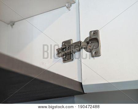 Metal door hinges on the wardrobe door