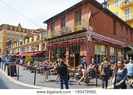NICE, FRANCE - JUNE 4, 2017: A view of the busy ambiance in a street in the Vielle Ville, the Old Town, of this popular city in the French Riviera