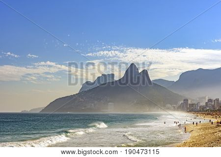 View of Ipanema beach at summer day with the Twoo Brothers hill and Gavea stone at background