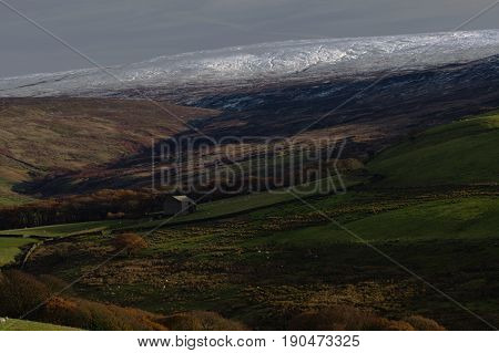 Sunlit ridges, shady valleys and snowy hills in Lancashire