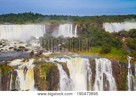Boiling water creates rainbow. The concept of extreme and exotic tourism. Iguazu Falls National Park - grandiose complex of waterfalls on the border of Argentina, Brazil and Paraguay