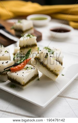 Dhokla or sandwich dhokla / Indian savory snacks made of chick pea flour or rice flour, selective focus