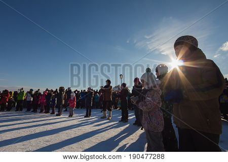 Kazan, Russia - 28 february 2017 - Sviyazhsk Island : Russian ethnic carnival Maslenitsa - Adults and children lined up in a circle for winter games a frosty sunny day