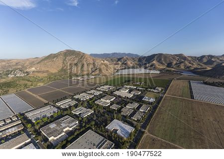 Aerial view of farm fields and Industrial Buildings near Camarillo in Ventura County, California.