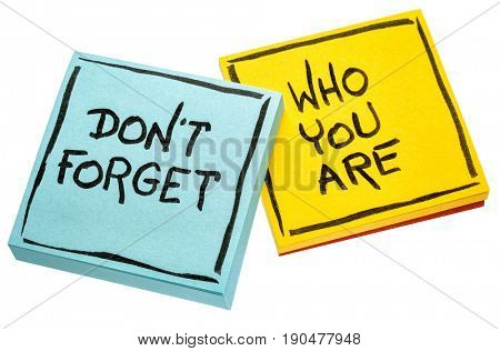 Do not forget who you are - handwriting on isolated sticky notes