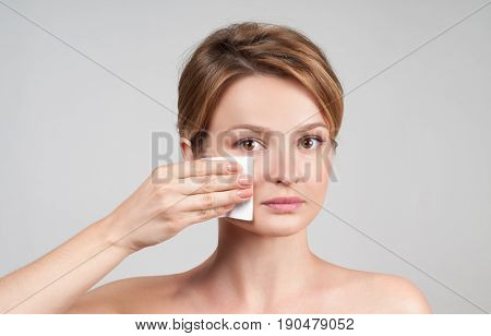 Beauty. Woman Removing Makeup With Cotton Pad.