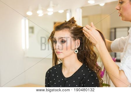 Hairdresser doing haircut for women in hairdressing salon. Concept of fashion and beauty. Positive emotion poster