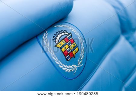 PAAREN IM GLIEN GERMANY - JUNE 03 2017: Emblem in the form of embroidery on the seat-cover of a full-size personal luxury car Cadillac Eldorado. Exhibition
