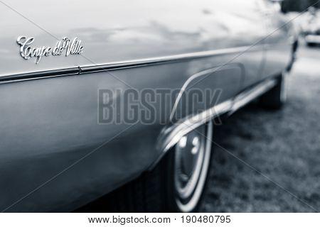 PAAREN IM GLIEN GERMANY - JUNE 03 2017: Detail of the Cadillac Coupe de Ville. Stylization. Toning. Exhibition