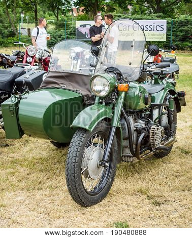 PAAREN IM GLIEN GERMANY - JUNE 03 2017: Soviet heavy motorcycle with a sidecar IMZ-Ural. Exhibition