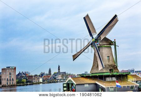 Wooden Lumber Windmill Zaanse Schans Old Windmill Village Countryside Holland Netherlands. Working windmills from the 16th to 18th century on the River Zaan. Windmills powered industries in Holland such as ship builidng vegetable oil production.