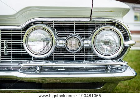 PAAREN IM GLIEN GERMANY - JUNE 03 2017: Headlamp of a full-size car Oldsmobile 88 (Fourth generation). Exhibition