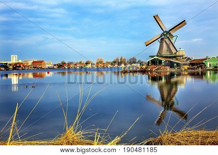 Wooden Windmill River Zaan Zaanse Schans Old Windmill Village Countryside Holland Netherlands. Working windmills from the 16th to 18th century on the River Zaan.
