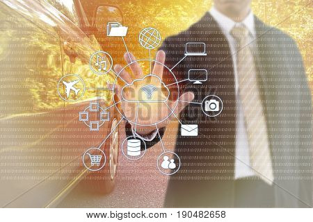 Businessman hand touching on virtual screen. Internet and Cloud Technology. Car on the road in background.