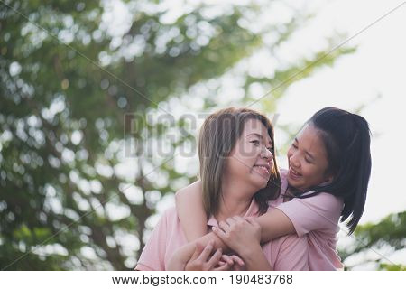 Asian mother and daughter in happines at the outside in the park