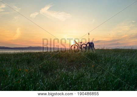 Biking in the hills at sunset with toddler in child trailer