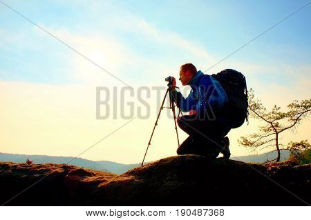 Amateur Photographer Takes Photos With Mirror Camera On Peak Of Rock. Dreamy Fogy Landscape, Spring