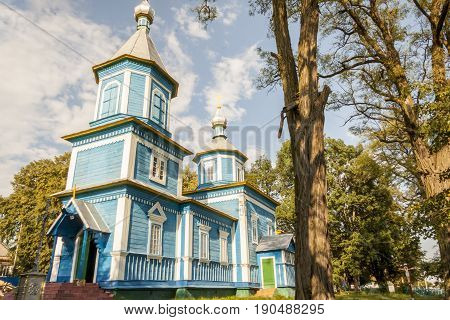 Small blue wooden old orthodoxy church - Ukraine Europe.