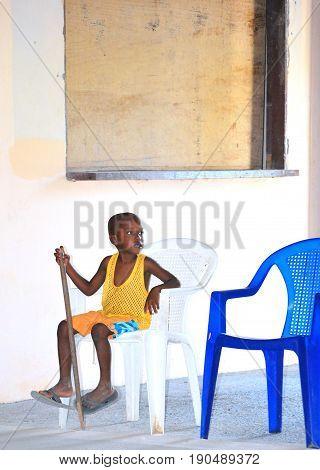 SAINT THOMAS, VI. MAY 11, 2011. CIRCA: Caribbean boy posing for tourist outside for money.