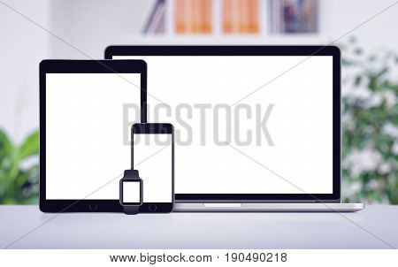 Set of modern technology devices template for responsive design presentation. Mockup consist of laptop, smartphone tablet pc and smart watch on office desk.