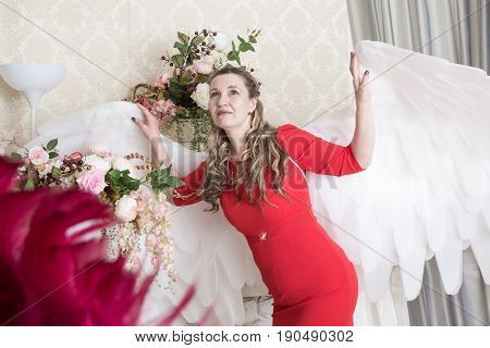 Ugly Woman In A Red Dress With White Angel Wings