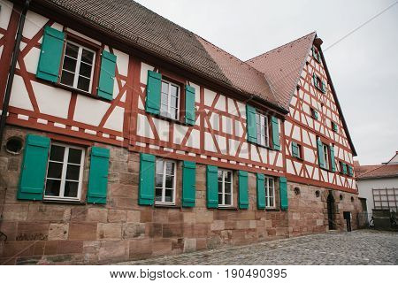 Traditional house in the German style in Bavaria. The architecture of houses in Germany. Europe.