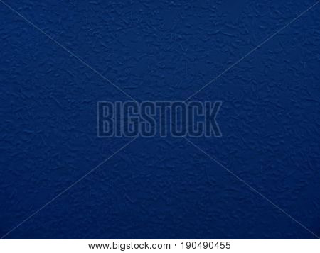 Dark blue textured wall closeup. Blue abstract background.