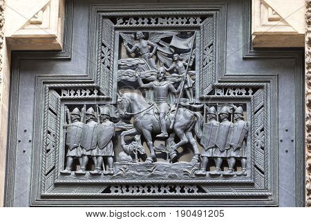 14th century St. Vitus Cathedral facade relief details of the doorPrague Czech Republic It is a Roman Catholic metropolitan cathedral in Prague the seat of the Archbishop of Prague.