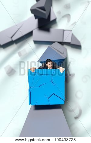 businessman holding on to a collapsing block of a bar chart.