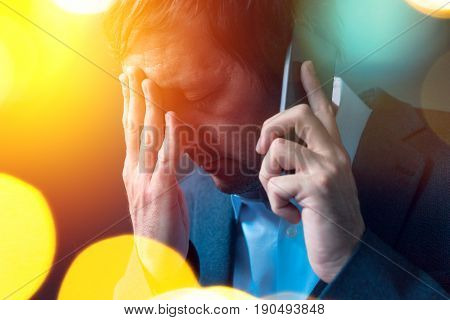 Bad news businessman conducting unpleasant phone conversation with his superior manager getting fired or salary pay cut